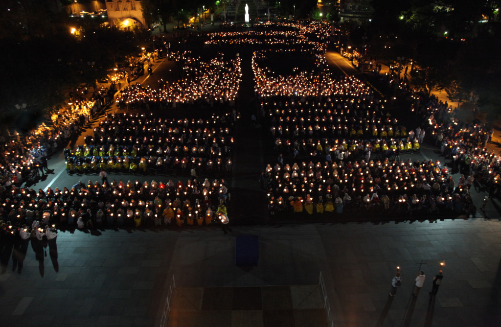 prayer by candlelight at Lourdes