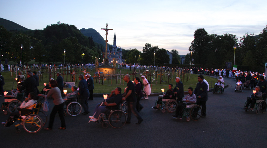 procession at dusk in Lourdes