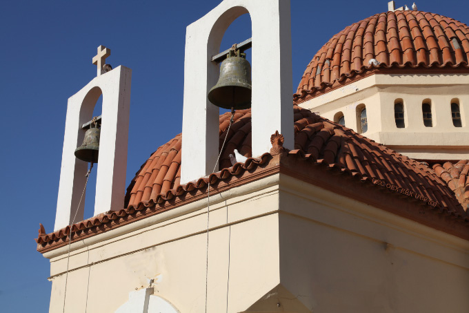 Church bells and doves by sea in Rethymno