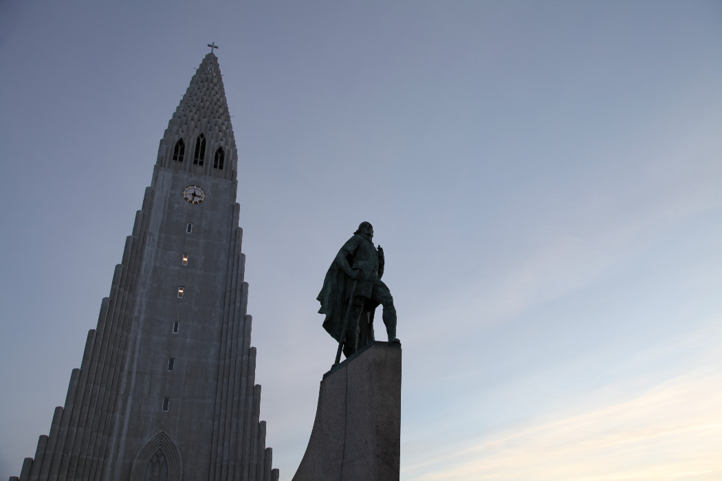 Hallgrímskirkja and Leifr Eiríksson sculpture by A.S. Calder with Cross and in chainmail with sword and battleaxe —  the Old Evangelization