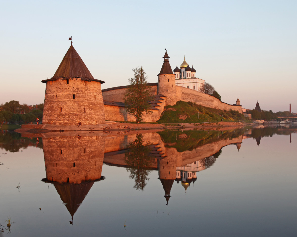 Pskov Kremlin at the point where the Pskov River flows into the Great River, the Flat Tower stands nearest and is reflected in the Pskov River