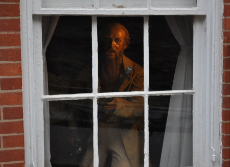 uec_usa_west_virginia_harpers_ferry_man_gun_window